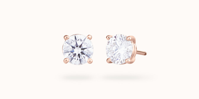 Boucles d'oreilles quatre griffes - Or rose 18K (2,00 g), 2 diamants 0,60 ct