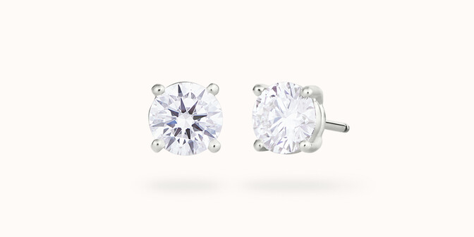 Puces d'oreilles quatre griffes - Or blanc 18K (2,00 g), diamant 0,6 ct - Courbet
