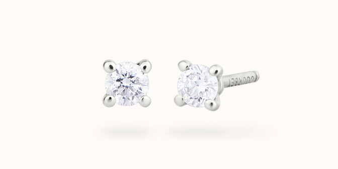 Boucles d'oreilles quatre griffes - Or blanc 18K (1,00 g), 2 diamants 0,20 ct - Courbet